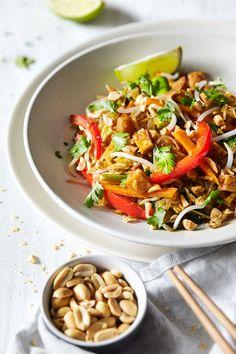 "Spaghetti Squash Pad Thai A delicious pad thai dish made with colorful veggies, crispy tofu and spaghetti squash ""noodles"". Features an easy, lip-smacking vegan pad thai sauce. Authentic flavors with a twist. Vegan & Gluten Free."