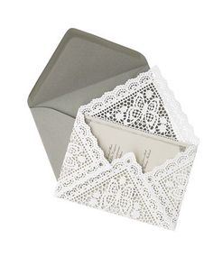 Lacey invitation liners made from 9-inch square doilies.