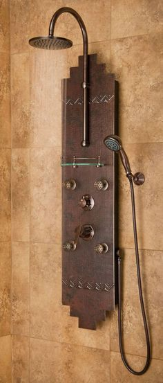 Hand-forged hammered copper panel and oil rubbed bronze components are tooled in Sante Fe style. Featuring four 3-function brass Infinity Jets™ with 3 spray patterns, a brass rain shower head and a multi-function hand shower. $600 (http://www.pulseshowerspas.com)