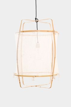 Pendant lamp by Ay illuminate. This lamp is handmade and has a natural colored bamboo frame, finished with a white silk cashmere fabric. This lamp has a diam.