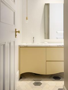 A artful blend of traditional and contemporary in this family bathroom.