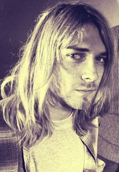 Cobain.. looking  like a young robert plant. Wow.