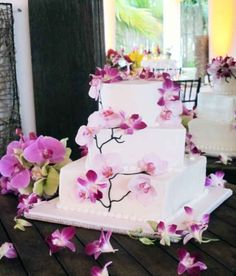 Wedding Cakes: Wedding cake with purple orchid flowers