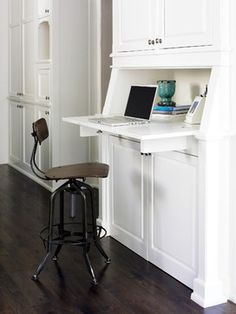 Have always loved the idea of having a desk/office space in the kitchen...but this is even better because you can hide it away when you're not using it!