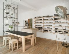 Aesop Rough Trade Nottingham – UK ~ A complicated assemblage of glass beakers and steel tubes emits scents into this outpost of skincare brand Aesop, designed by Paris studio Ciguë above a record store in Nottingham, UK. The three-tiered contraption includes a glass kettle, live plants and feeding taps – connected by a series of pipes – and is situated in the center of the room.