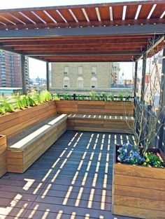 "Ipe planters, ipe and metal pergola, ipe benches with storage built-in. ""Few woods can match thenatural beauty of ipe (pronounced ee-pay), a hardwood with a life expectancy of 30 years.""--Amber Freda NYC Home & Garden Design Blog"