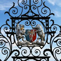 Armorial detail from the Bodley Gates at Powis Castle in Welshpool, Wales. Features the coat of arms of Herbert, Earls of Powis, with an escutcheon of pretense for Lane-Fox, Barons Darcy de Knayth.  The gates were a gift to George, 4th Earl Powis from his wife, Violet, daughter of Sackville Lane-Fox, 15th Baron Darcy de Knayth