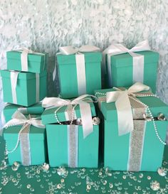Want a bit more glam? Try these handmade 4x4x4 bling gift boxes with ribbon. Featuring pearls and bling ribbon, these beauties may steal the spotlight. Leave them closed or fill them up with more blin