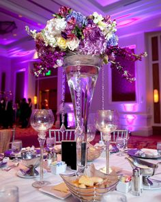I really love these tall centerpieces that start small at the bottom and get larger toward the top. The hanging crystals are the icing on the cake.
