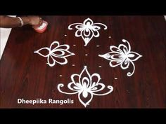 Design Discover simple lotus rangoli design with 9 dots l small daily kolam designs l easy rangoli designs Rangoli Borders, Rangoli Border Designs, Small Rangoli Design, Rangoli Designs Images, Rangoli Designs With Dots, Rangoli With Dots, Beautiful Rangoli Designs, Henna Designs, Blouse Designs