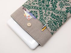15 inch Macbook Pro case. Dark linen macbook 15 case with green poppies pocket and button closure. Custom order available.. $27.90, via Etsy.