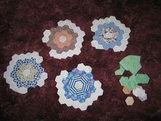 Antique Hand Pieced Quilt Blocks Grandmothers Flower Garden C1930s | eBay.  Almost done . . . .