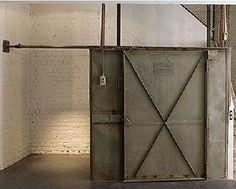 Barn doors that slide in front of shelves or across master for privacy