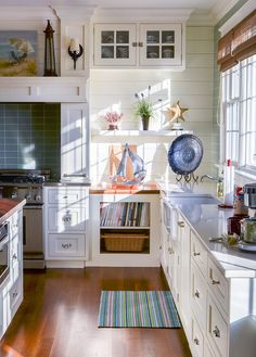 The coastal kitchen with serious performance in countertop surface, tile and appliances