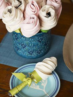 How cute for a party!! -- Instructions on how to create these napkin flowers.