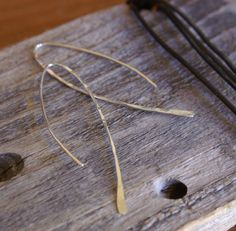 """Feather Earring- Silver wire is formed and hammered into a lovely free form feather shaped earring.  2.25"""" long"""
