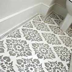 A stunning bathroom floor created by using an Autentico stencil and paint!