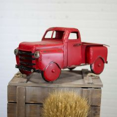 Put this red metal pick up truck on any bookshelf for a pop of color and added rustic character. Shop this and other shabby chic home decor today!
