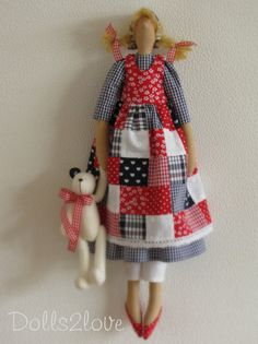 Tilda doll Babbette wearing a red, white and blue patchwork pinafore dress accompanied by her little teddy bear Gingham Fabric, Blue Gingham, Realistic Baby Dolls, Fabric Gift Bags, Victorian Lace, Patch Kids, Pinafore Dress, Fabric Dolls, Rag Dolls
