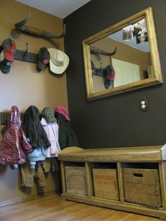 love this! I need to repaint the laundry room...dark charcoal/brown?   I love the horns up above all the hooks!