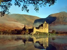 Kilchurn Castle (Loch Awe, Scotland)  What a ruin! Built in the mid 15th century by Sir Colin Campbell, First Earl of Glenorchy, Kilchurn Castle's substantial ruins provide some of the very best Loch-side views in all of castle-rich Scotland.