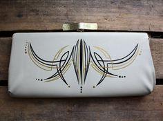 Metallic gold & black pinstriping on an ivory vintage purse.