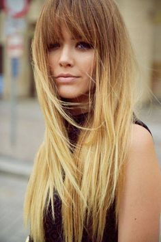 In love with her hair! Long fine hair with layers and blunt bangs.