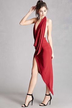 A smooth stretch knit halter dress featuring a draped front neckline, an elasticized back, and an asymmetrical skirt. This is an independent brand and not a Forever 21 branded item.