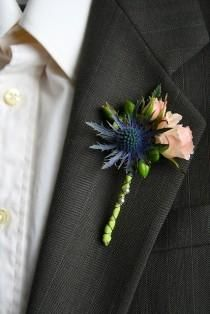 can we make a boutonniere with blue thistle? Blue is a theme color for the wedding (like the invites ; Thistle Boutonniere, Groomsmen Boutonniere, Groom And Groomsmen, Boutonnieres, Prom Flowers, Wedding Flowers, Floral Wedding, Wedding Bouquets, Bracelet Corsage