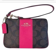 Authentic coach signature wristlet Authentic signature coach brown and ruby pink leather wristlet. Will fit cell phone, money credit cards, lipstick in it, Measurements 6x4x1. Comes with coach gift box and tissue paper. Coach Bags Clutches & Wristlets