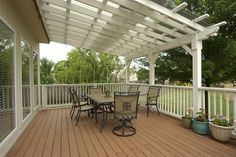 covered deck - pergola with clear cover on top - interesting...and likely less expensive than a full roof.  Lots of light too.