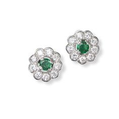 A Pair of Emerald and Diamond Cluster Earrings   Each formed as a flowerhead, set centrally with a round brilliant-cut emerald surrounded by a frame of round brilliant-cut diamonds, diameter ½ in.