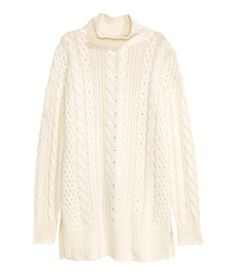 Natural white. Long, cable-knit turtleneck sweater in a soft cotton blend. Long sleeves, ribbed cuffs, and a ribbed hem with slits at sides.
