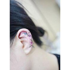 Rose on ear tattoo by @tattooist_banul
