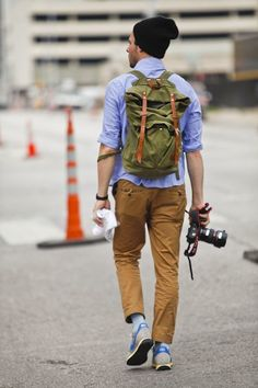 Olive Backpack styled with Light Blue Long Sleeve Shirt , Mustard Chinoes and Grey Sneakers