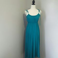 Aqua blue maxi dress Excellent condition. self tie straps. 100% rayon. Fast shipping! Reasonable offers accepted! Thank you for shopping my closet! Xo xo Dresses Maxi
