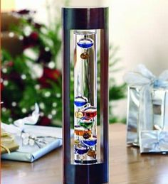 Galileo Thermometer with Cherry Finish Wood Frame in Holiday 2012 from Wind & Weather Galileo Thermometer, Weather Instruments, Jewel Tone Colors, Jewel Tones, Cherry Finish, Colored Glass, Wind Chimes, Indoor, Wood