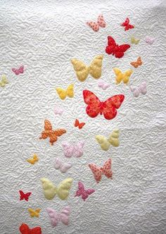 Make a baby blanket in no time at all with this simple baby quilt pattern. With butterfly applique and a pink ruffle trim, the Butterflies a Flutter Baby Quilt Pattern has a crisp white background, covered in free-motion quilting. Quilt Baby, Baby Quilt Patterns, Onesie Quilt, Butterfly Quilt Pattern, Butterfly Template, Quilting Projects, Quilting Designs, Sewing Projects, Quilt Design