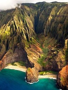 NA PALI COAST, KAUAI, HAWAII No roads cross these rugged, folding-fan cliffs. In their place are waterfalls, swift streams, and lapping waves that stretch endlessly in alternating shades of blue. a day (or two) spent lying on gorgeous Kee Beach is advisable, too. Reef protection creates a small sandy-bottom lagoon perfect for snorkeling, while the emerald green pinnacle of Makana looms artfully in the background.