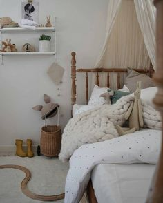 Talan's beautiful room  That vintage bed is amazing! @kerryann_stylist always adds a little bit of magic when creating her kids' spaces  Our OYOY Wooden Penguin sits happily up on the shelf x  w w w . m i l k t o o t h . c o m . a u