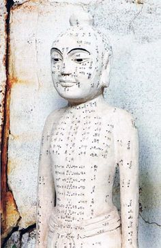 old acupuncture doll
