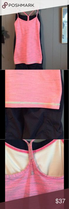Pink and gray or silver Lululemon Athletica tank Gently worn two times like new silver gray and pink  racer back tank . lululemon athletica Tops Tank Tops