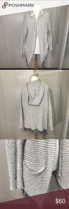 FREE PEOPLE Free people thick cardigan. Two pockets on each side, and a hoodie. Brand new condition! Size is Small, but it's oversized, so it fits a Medium as well. Free People Sweaters Cardigans