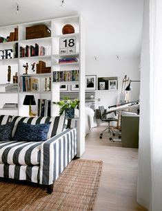 Using a bookshelf to divide a small space.