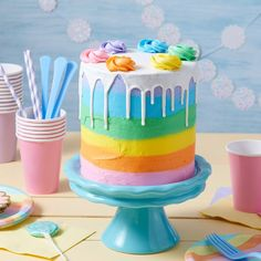 Make this happy over the rainbow cake as the perfect DIY sweet treat craft for any party.
