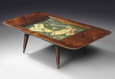 GIO PONTI (1891-1979) & EDINA ALTARA (1898-1983) OCCASIONAL TABLE, LATE 1940s probably executed by Giordano Chiesa, Ferrera walnut, glass and oil on board 15 in. (38 cm.) high; 53½ in. (136 cm.) wide; 27½ in. (70 cm.) deep envelope to trompe l'oeil panel addressed Architetto Gio Ponti, Via Gaffi 24, Milano (Italia).
