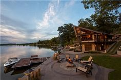 Breathtaking lakeside patio with fire pit takes full advantage of the surrounding view.  Great example of integrally colored flatwork.  Creative Construction by Design, a Corp.  Danville, IL