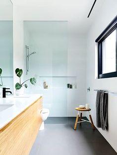 Black tap. Wood vanity. Hung vanity. natural light.