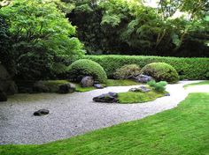 zen garden borders are key: here a hedge serves as a great background to highlight the yin stone against the evergreen yang cedars. all in balance..