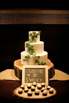 Rustic Themed Green and Ivory Wedding Cake with Cupcakes